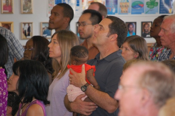 Part of the team worshiping at Living Hope.  Mike Sciarra holding a sweet baby girl from the Baby Home.