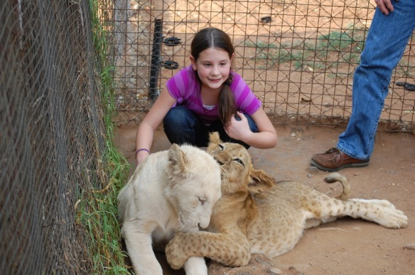 Hannah Bush with lion cubs