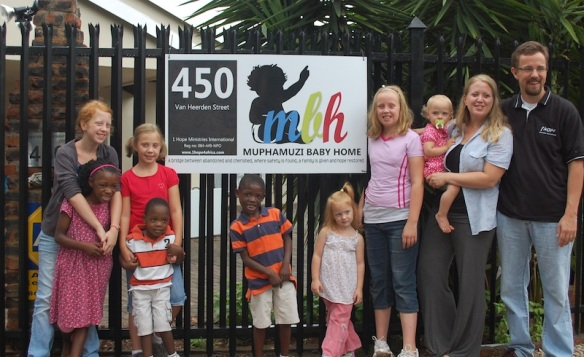 The Mack Family in front of the Muphamuzi Baby Home on opening day!