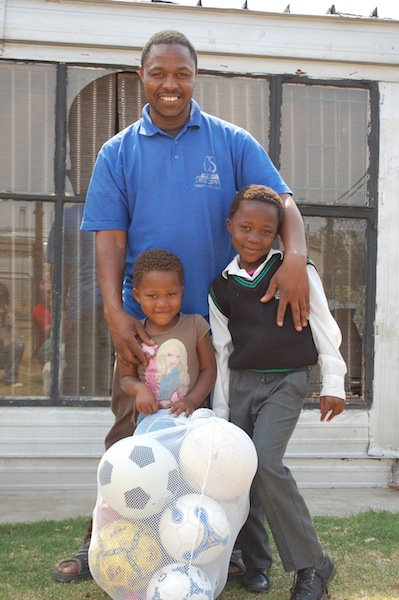 Pastor James with his two younger children.
