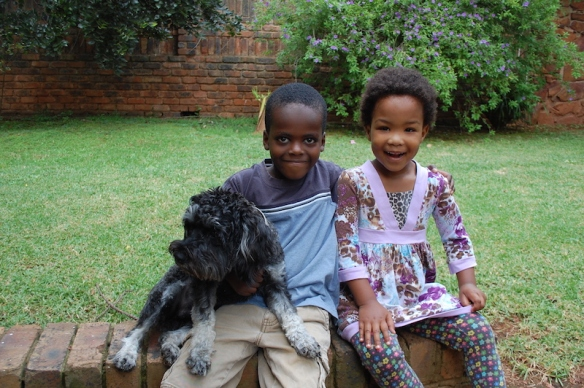 Chisomo with Elijah and Sammy in our backyard.