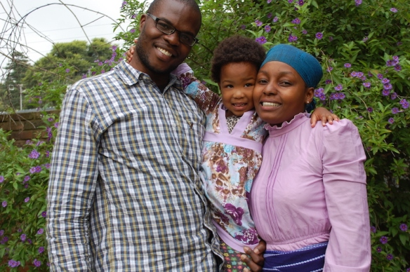 "Newton and Vanessa with Chisomo. (formerly ""Aya"".  Chisomo means ""Grace"")"