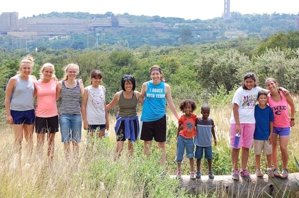 Hosea's Heart Missionaries and Muphamuzi Baby Home interns out for a hike  in the nature reserve just outside Pretoria.  University of South Africa in the background.