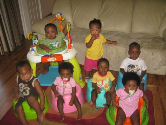 Can you figure out which babies are Simon and Chisomo? They are the two babies in the back row.